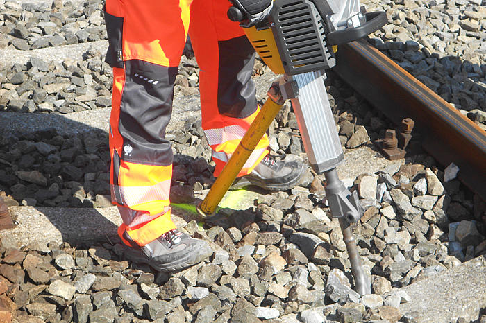 Tie tamping tool in use